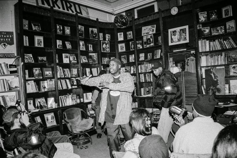 Talib Kweli at spoken word event at historic Nkiru Books in Brooklyn, NY [circa 1998-99].