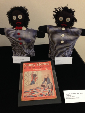 MCLM Collection | Golliwog dolls were based on black characters and depictions in children's books in the late 19th century. The rag doll is characterized by black skin, eyes outlined in white, red clown lips and frizzy hair, which is often a reminder of the peculiar nature of minstrely, blackface caricatures and anti-black mis/representations in American and European iconography.
