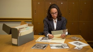 Screen shot from Citi Progress Makers doc of Gina Nisbeth, Director of Community Capital at Citi, observing photograph from Schomburg collection.